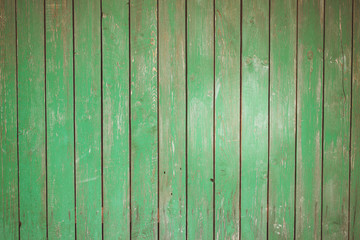 Wooden plank texture, background. Green slatted Wood garden or house Fence