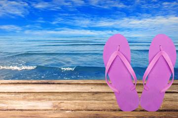 Pair Of Flip-flops Against Sea. Black Sea
