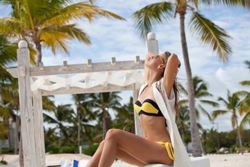 Summer vacation happiness carefree joyful woman enjoying tropica