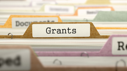 Grants Concept on Folder Register in Multicolor Card Index. Closeup View. Selective Focus. 3D Render.