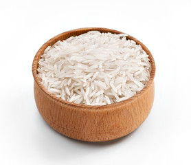 Rice in wooden bowl on white background. Close up, high resolution product.
