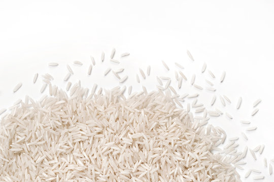 Close up of white rice  on white background. Top view, high resolution product.