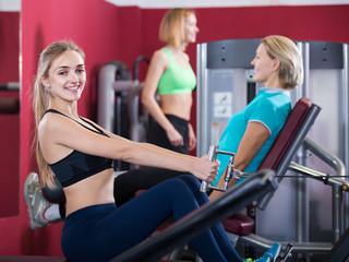 people  weightlifting training in modern health club