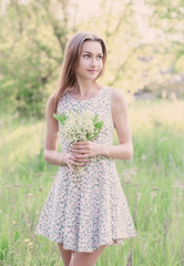 beautiful girl with lily of the valley