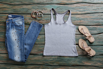 Jeans and gray tank top. Blue denim pants and sandals. Woman's brand new stylish jeans. New arrivals in brand shop.