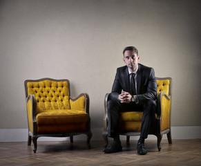 Serious businessman sitting