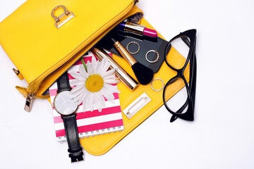 Wall Mural - Female accessories in bag . Top view