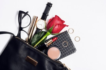 Wall Mural - Female fashion accessories in black cosmetic bag.