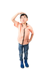 Little boy checkin his height on white background
