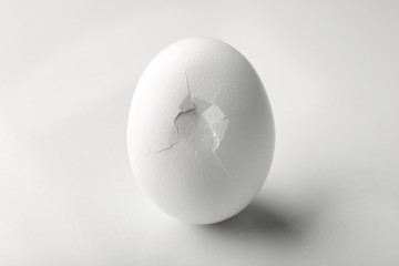 Cracked egg on white background
