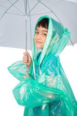 Little boy wearing rain coat on white background