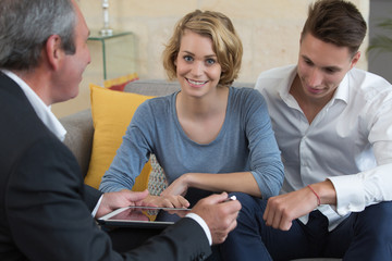 young couple meeting real-estate agent
