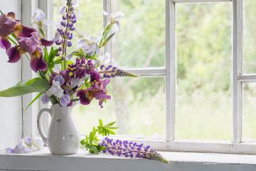 Flower vase sitting inside of window