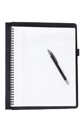 close up shot of spiral notebook with pen