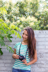 teen smiling and taking photos of nature