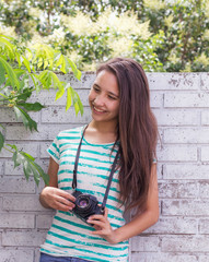 teenager smiling nature with old camera