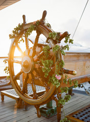Steering wheel on ship decorated with flowers