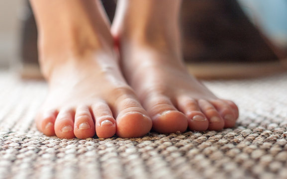 Young boys feet standing on carpet