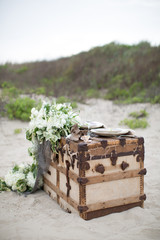 Two place settings on trunk, on beach