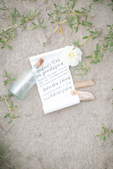 Wedding invitation themed as message in a bottle