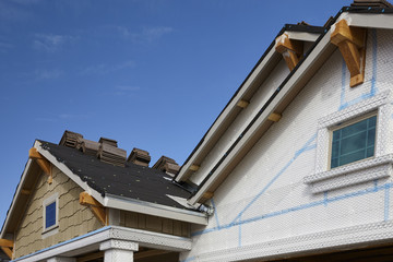 Home building industry gable roof slope transition and stucco ro