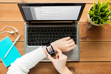 close up of woman with smart watch and laptop