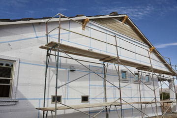 Home building industry house scaffolding for stucco and insulati