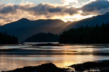 Sunlight over mountains and lake, haida gwaii, british columbia