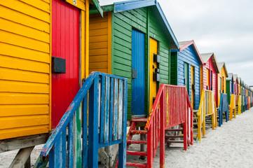 Colourful beach huts on beach