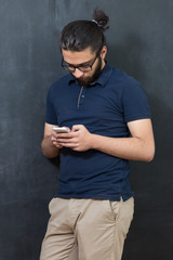 picture of young arab man on chalkboard using phone