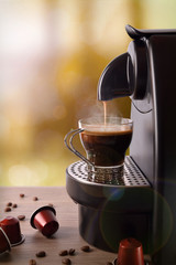 Espresso machine making coffee on wood table vertical compositio
