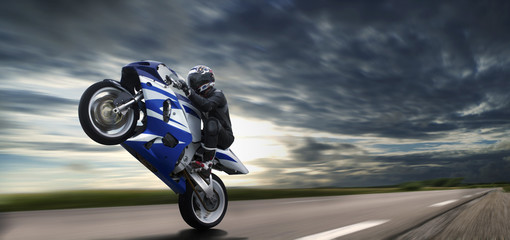 Fast Wheelie On Blue Motorbike