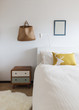 Bedroom details of retro decor side table and wall ornaments