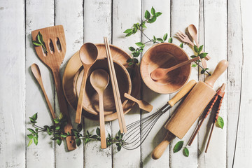 Overhead view of wood utensils on rustic wood table, Top view of