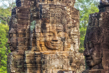 Stone faces at the ancient Bayon temple at Angkor, Siem Reap, Cambodia.