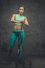 Full body picture of sporty female in azure sportswear.