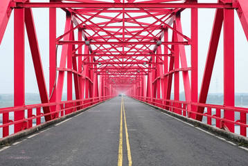Symmetrical red steel structure construction of bridge and road in Xiluo, Taiwan