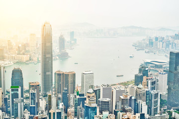 Business concept for real estate and corporate construction - panoramic modern city skyline bird eye aerial view with dramatic sunrise and morning blue sky in Hong Kong (HK), China