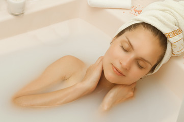 Girl with closed eyes in the bath