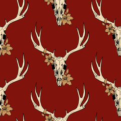 deer skull  and lily on a red background vector seamless pattern