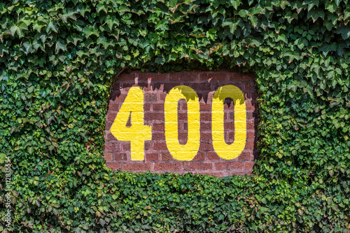 Wall mural 400 feet sign on the outfield wall of Wrigley Field in Chicago, Illinois