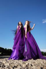 Women in violet dresses