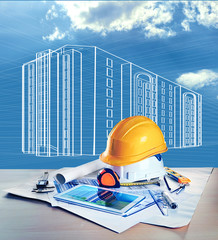 Table with construction drawings and other tools sky background with vector house picture