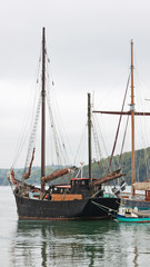 Traditional wooden sailing vessel moored in the river Fal in Cornwall