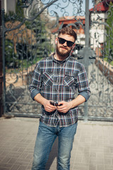 Man with gadget and glasses