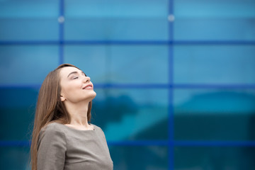 Portrait of business woman relaxing and feeling happy. Copy spac