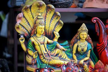 Colorful statue of hindu god Vishnu and Goddess Lakshmi