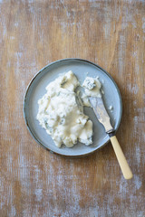 Creamy italian blue cheese Gorgonzola Dolce on the plate