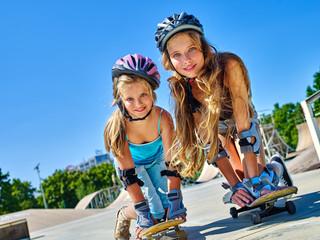 Children in helmet skateboarding on his skateboard outdoor. Low section. Childhood with skateboarding .