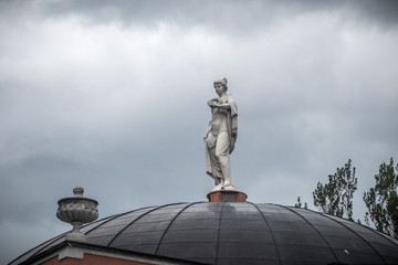 The woman's statue on the sky background